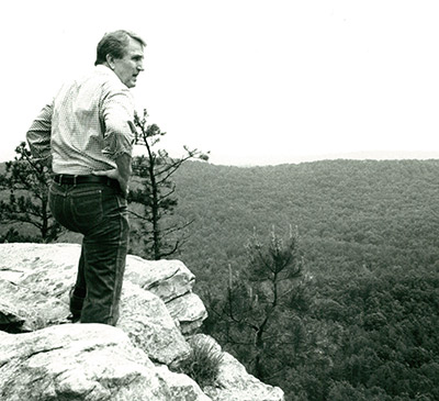 Senator Dale Bumpers looks over an Arkansas landscape set to become federally protected wilderness
